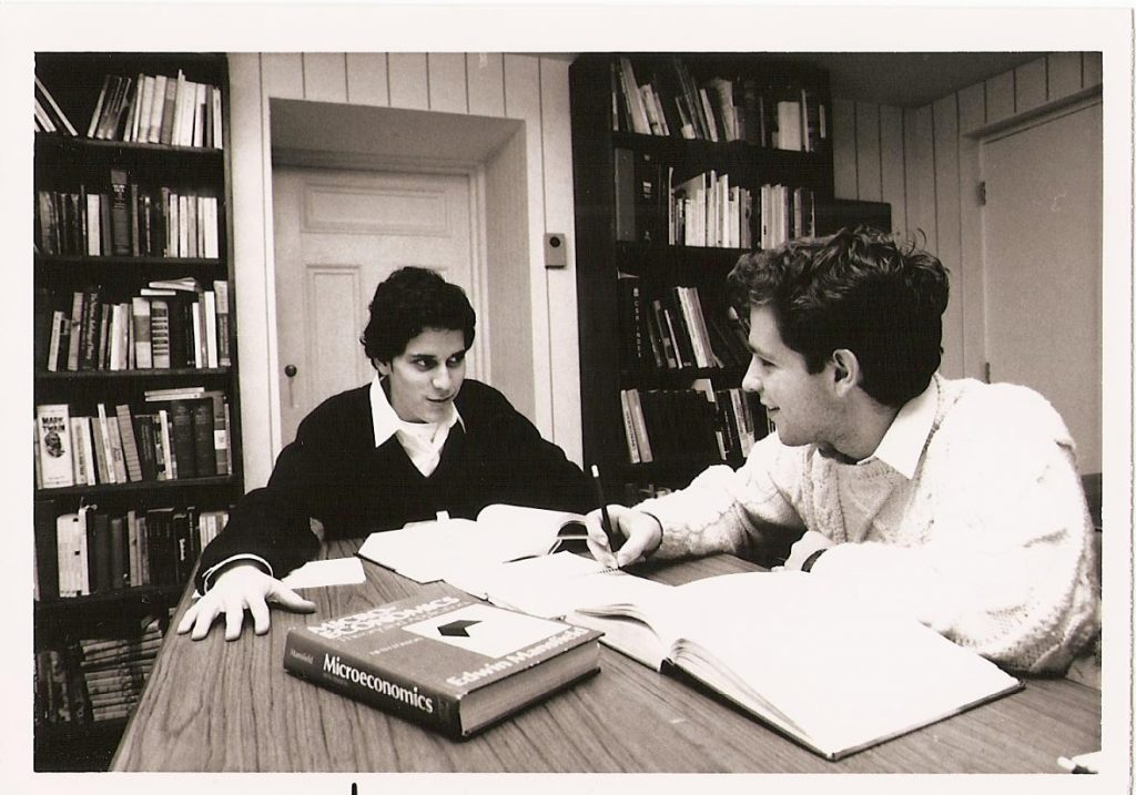 Two students studying in residence